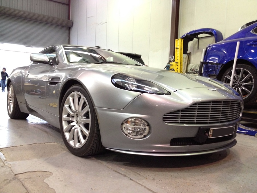 silver aston martin repaired by basha autohaus