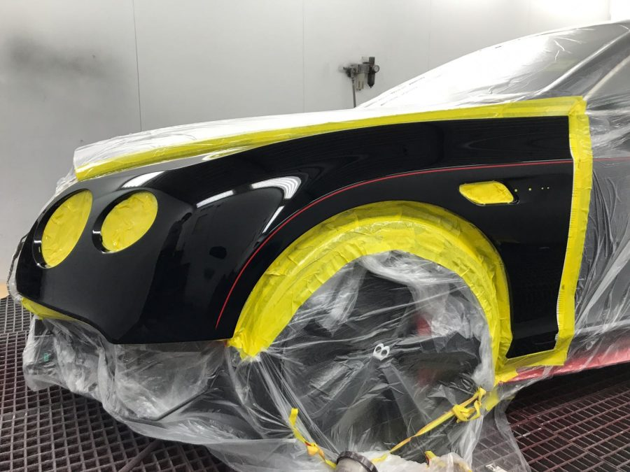 a car all taped up ready for a respray